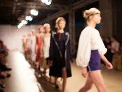 Models walk down a runway at New York Fashion Week