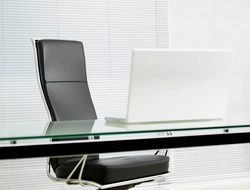 Empty desk chair in modern office