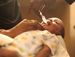 child receiving rotavirus vaccine