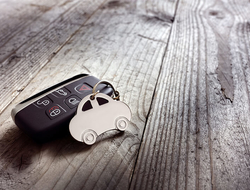 car keys on a wooden table