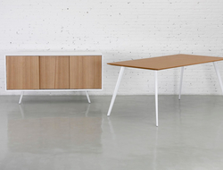 The casegood has formed steel tube legs and a wooden face, mixing materials for a contemporary yet classic look.