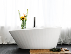 The bathtub collection, designed by Patrick Messier, has a design that follows a fluted shape and draws inspiration from the ebb and flow of the ocean.