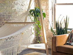 POUCH hammocks and hanging chairs fit into small spaces, with designer wall-mounted hardware or freestanding options, blending with existing design schemes.