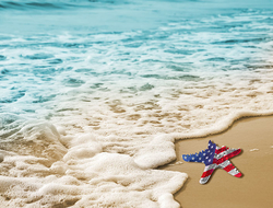 Starfish with an American flag pattern on a beach