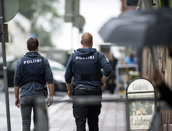 Armed police officers secure the area after several people were stabbed on the Market Square in Turku, Finland.