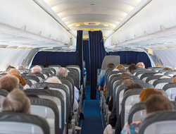 Airplane cabin with passengers