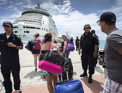 People walking toward Adventure of the Seas while the ship was anchored in St. Maarten after the passage of Hurricane Irma