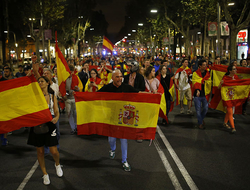 Anti-independence demonstrators waving Spanish flags march blocking main Diagonal avenue during a protest in Barcelona.