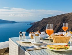 Breakfast on a balcony overlooking the ocean