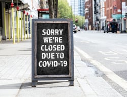 Sorry we're CLOSED due to COVID-19. Foldable advertising poster on the street