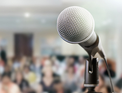 Speaker with microphone at conference