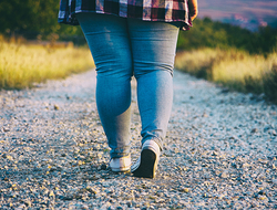 Obese Woman Walking Outdoors