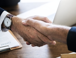 Handshake business deal executives