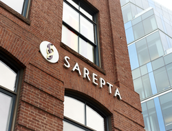 Redbrick building with Sarepta name and logo