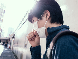Japanese man coughing with mask on