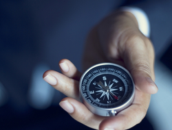 Compass in a man's hand