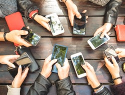 group of people with smartphones