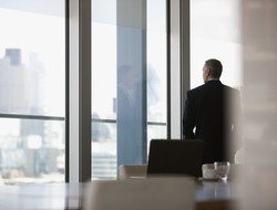 Executive looking out window