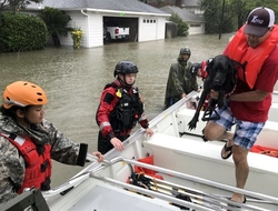 Man, dog enter boat during Hurricane Harvey rescue