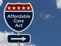 A signpost with the words Affordable Care Act