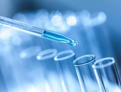 Blue-hued test tubes and dropper
