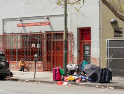 Homeless individuals line up outside Tenderloin Housing Clinic in San Francisco.