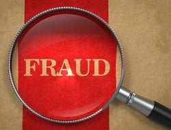 "A magnifying glass over the word ""fraud"""