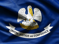 "Flag of Louisiana, which contains a pelican mother and three baby pelicans on a blue background with a white ribbon that says ""Union Justice Confidence"""