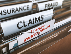 "File folders labeled ""insurance,"" ""fraud,"" ""claims,"" and ""under investigation"""