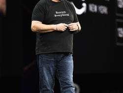 photo of Amazon CTO Werner Vogels on a stage giving a keynote speech