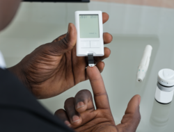 Patient measuring blood glucose