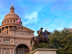 The Texas Ranger statue in front of the Texas Capitol building in Austin, TX