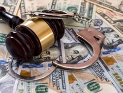Gavel money handcuffs fraud