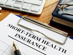 A paper reading 'short term health insurance'