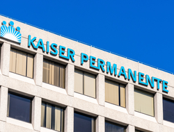 "The side of a building that reads ""Kaiser Permanente"""