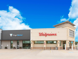 an exterior photo of a Walgreens store with Village Medical clinic next door