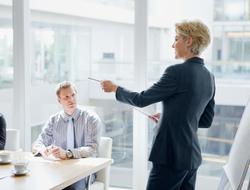 Female executive leading meeting