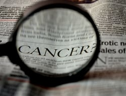 Cancer in newspaper clipping