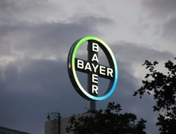 Bayer logo and dark clouds