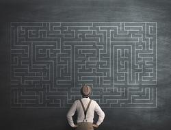 man staring at puzzle