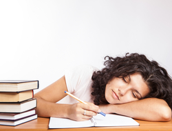 Image of girl asleep on books