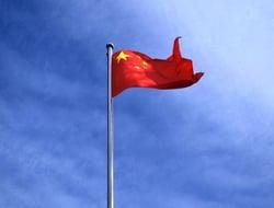 China flag against blue sky