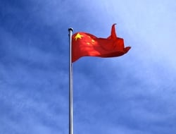 China flag against blue sky