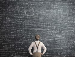 Complicated formula on chalkboard