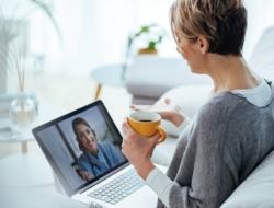 Woman having telehealth visit on her laptop