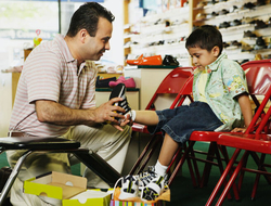 A father and son shop for sneakers