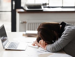 Woman sleeping at desk