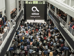 Altice USA logo amid crowd