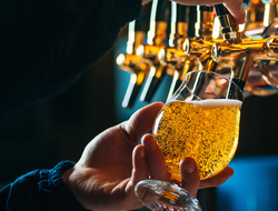 Closeup of bartender pouring a draught beer