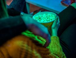 Binge TV watching bowl of popcorn